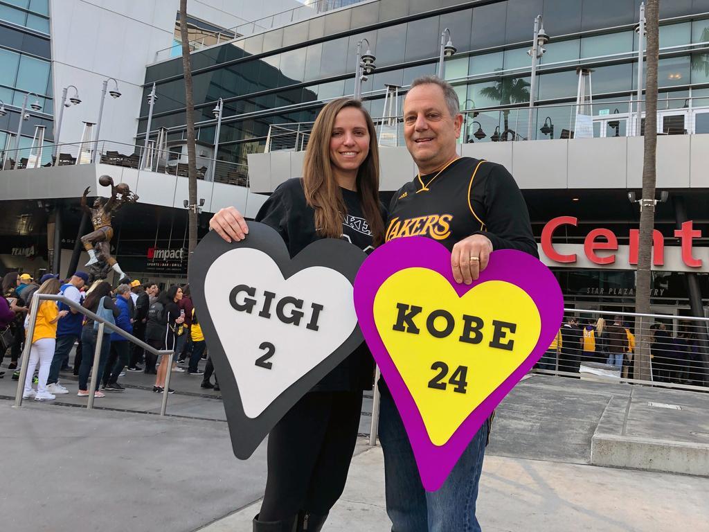 Alyssa Shapiro, 27, of Huntington Beach, and her father Rick Shapiro, 55, stand outside. (AP Photo/Stefanie Dazio)