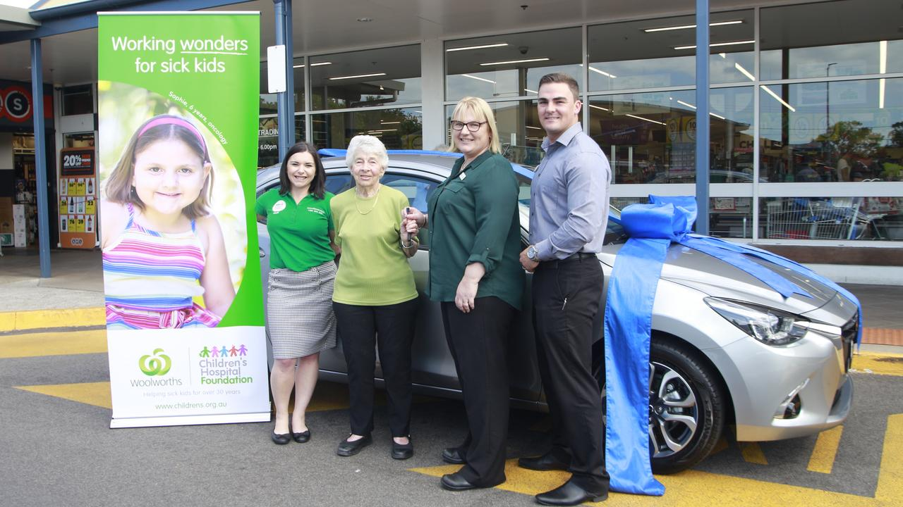 WOOLIES WINNER: One of 2019's winners Rita Hinton (centre) was handed over the keys to her brand new Mazda 2 GT Hatch.