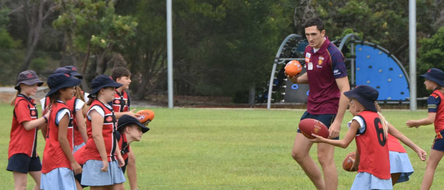 Looking to soak up the skills from the Lions young guns of AFL.