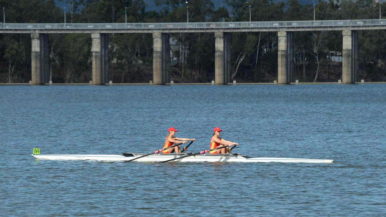 A pair of Stuartholme School rowers head out on to the course during the Queensland Secondary Schools Rowing Championships in Rockhampton in 2017.