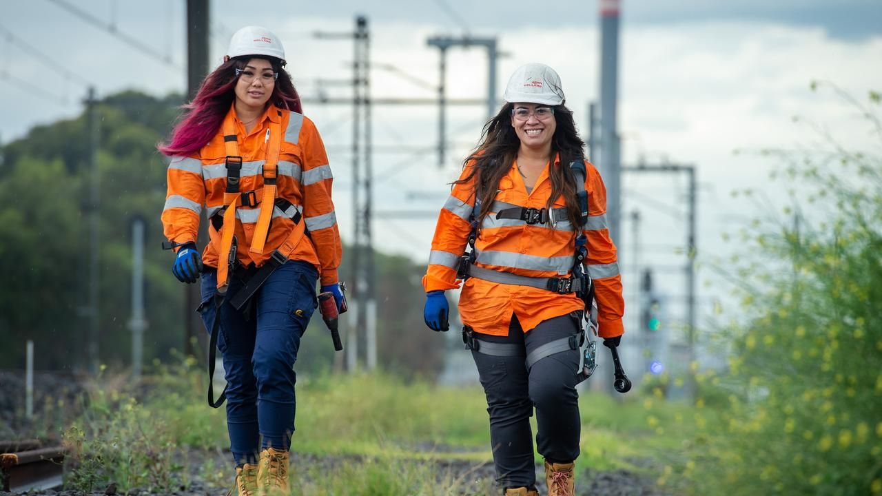 John Holland's Leanne Tran and Kerrie Griffin are rail apprentices at Newport and enjoy their jobs. Picture Jay Town