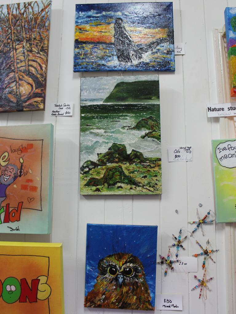 Some of Heather Krebs' oil paintings hanging on the wall at the Blackbutt Art Gallery. Photo: Laura Blackmore