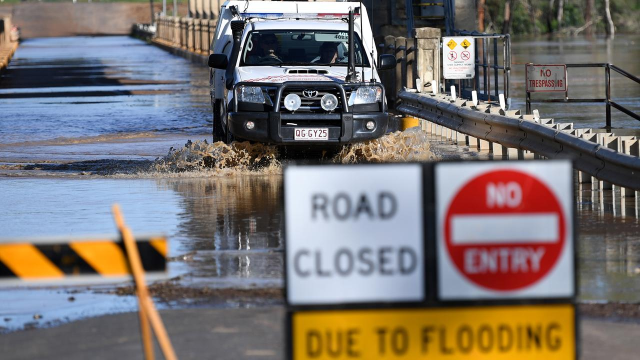 Water from the swollen Balonne river begin to flood the Andrew Nixon bridge in St George, southwestern Queensland. Picture: AAP Image/Dan Peled.