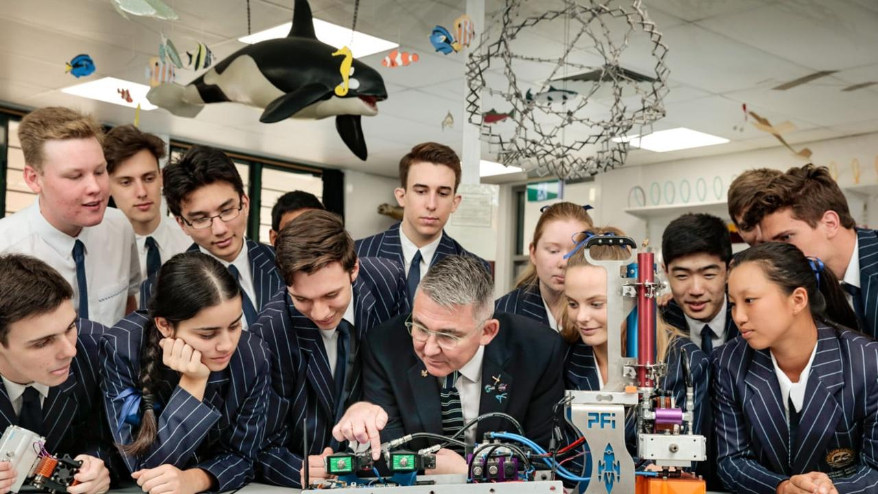 Students and a teacher at Sheldon College, Queensland which runs the Science of Rockets program with advanced manufacturing company PFI, who started the program after struggling to find skilled graduates.