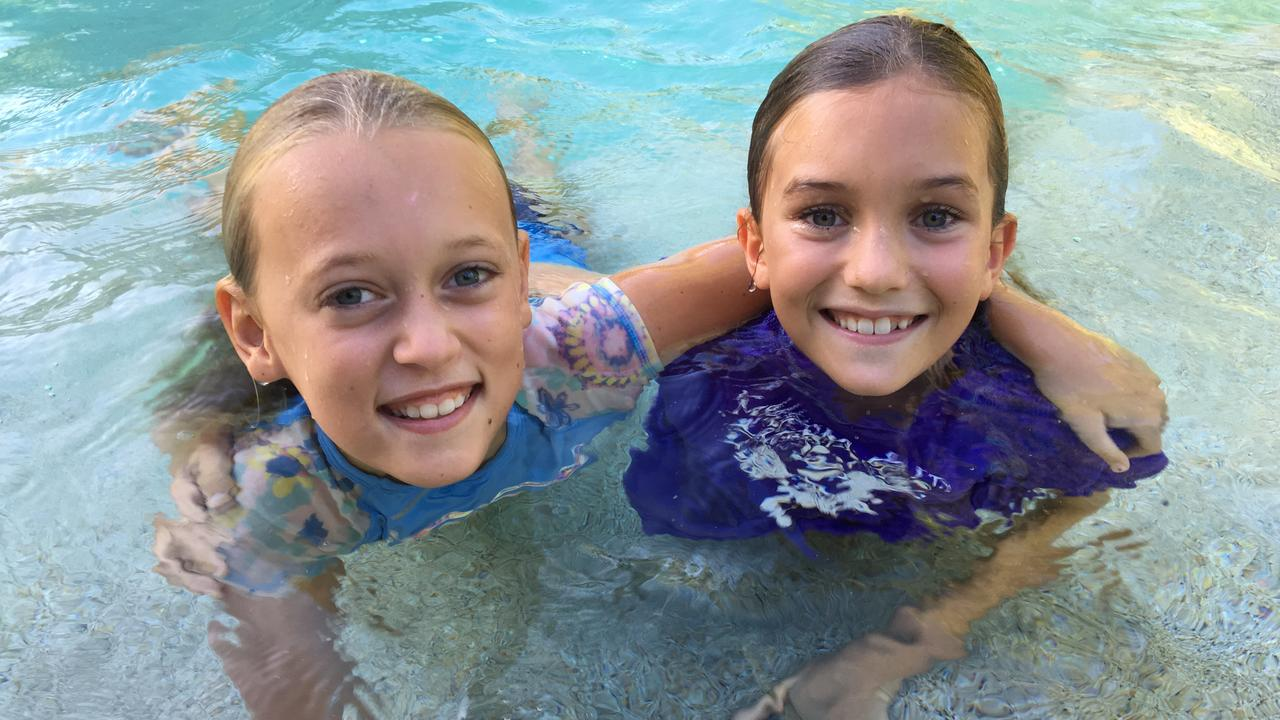 COOL KIDS: Sunshine Beach students Avalon and Teal are enjoying classes in the pool.
