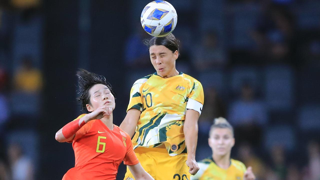 Matildas star Sam Kerr wins a header against China.