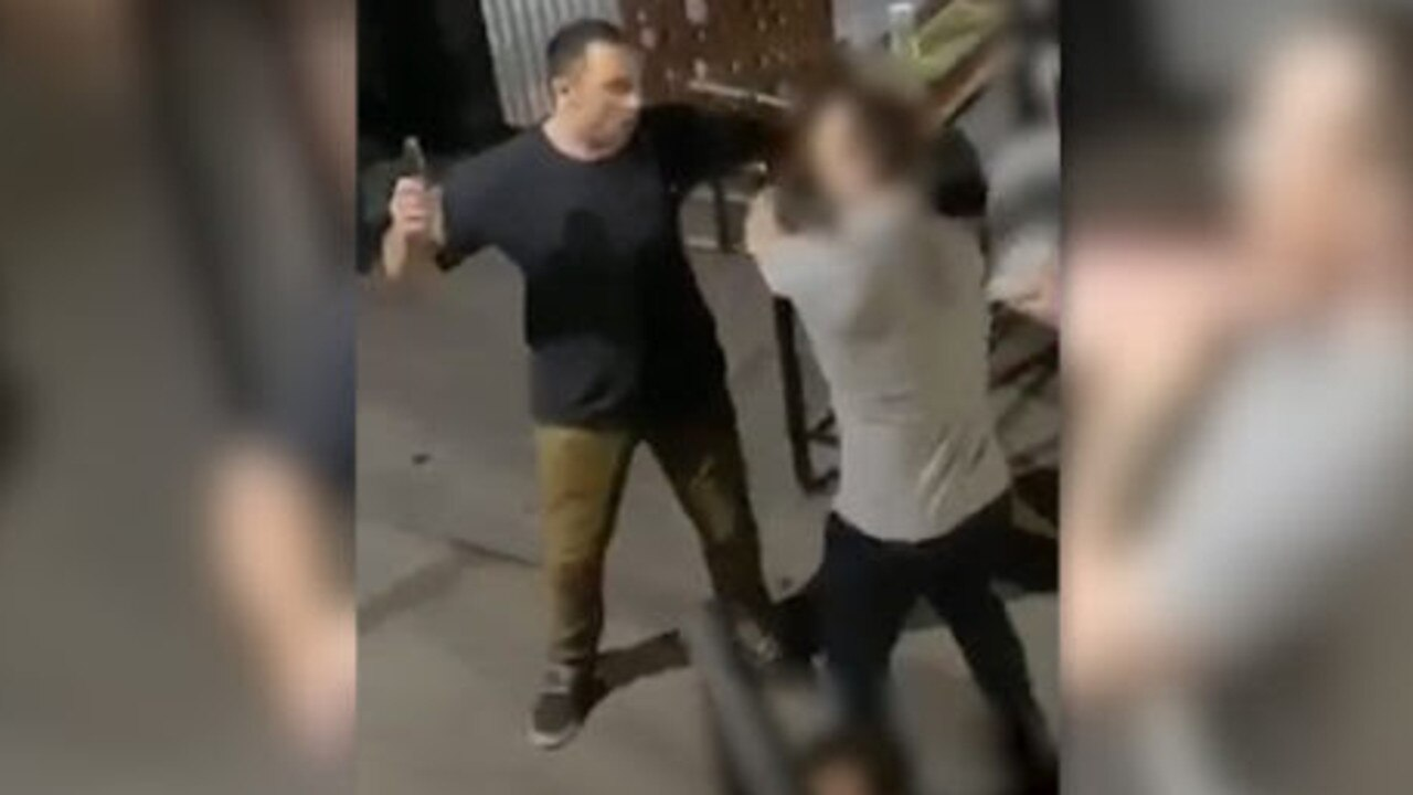 The moment a man used a piece of broken glass to slash his victim's face. Picture: Queensland Police Service