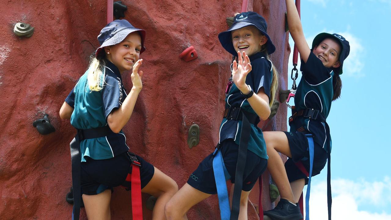 ROCK CLIMBING: Gympie primary school leaders Bella Gignac, Natasha Bailey and Ella Gratten on the rock wall. Picture: Shane Zahner