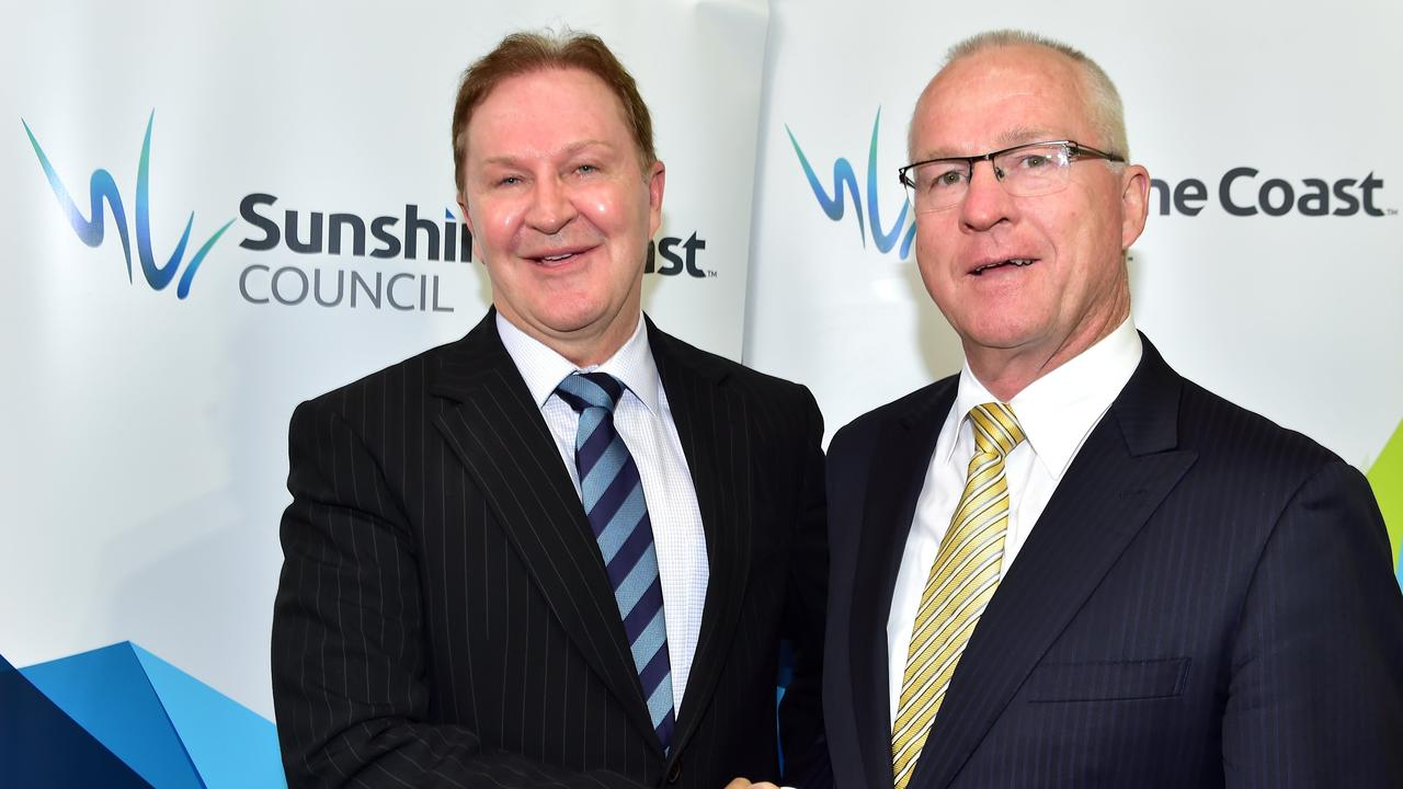 Sunshine Coast Council CEO, Michael Whittaker (left) shakes hands with Mayor Mark Jamieson after his appointment to a five-year term back in 2015. The council extended Mr Whittaker's contract in February, 2019.