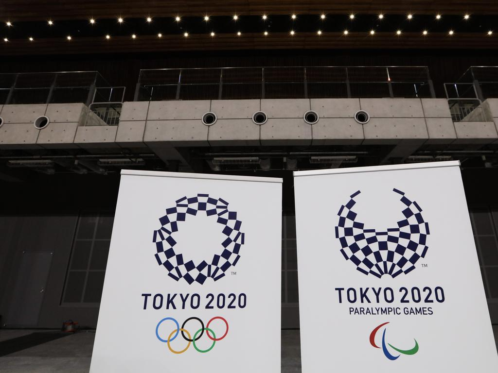 The logos for the Tokyo 2020 Olympics and Paralympics are displayed at a grand opening ceremony of the Ariake Arena, a venue for volleyball at the Tokyo 2020 Olympics and wheelchair basketball during the Paralympic Games. Picture: AP