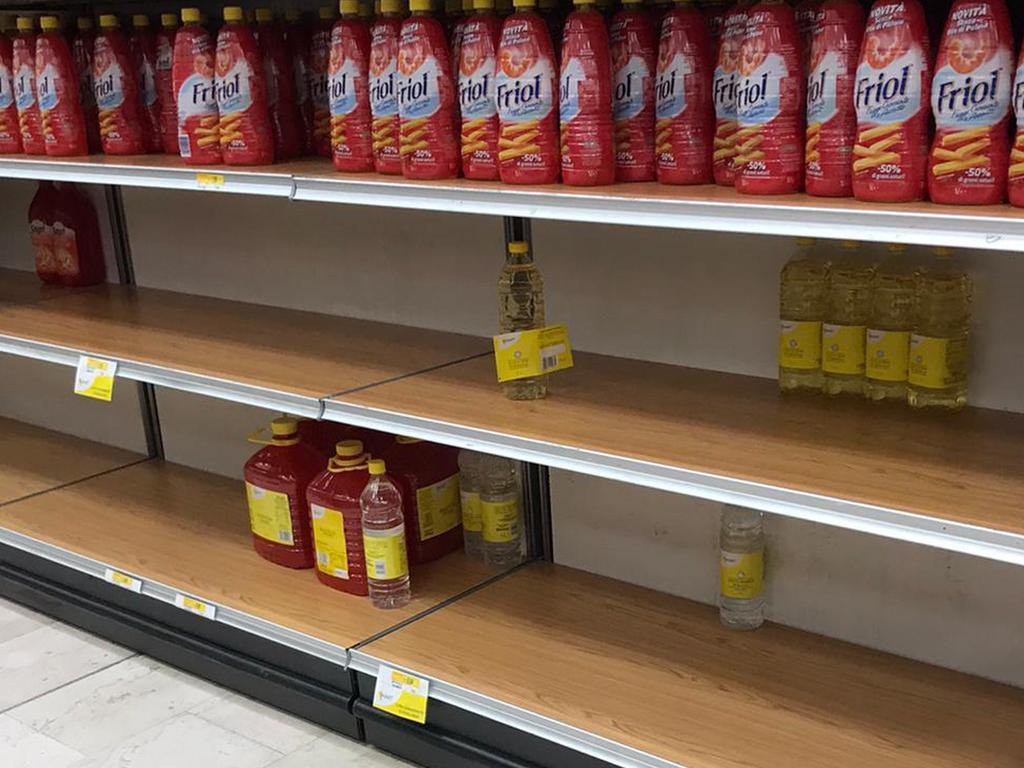 Empty shelves in a supermarket in Rozzano, near Milan where locals have been panic buying supplies. Picture: Antonio Calanni/AP