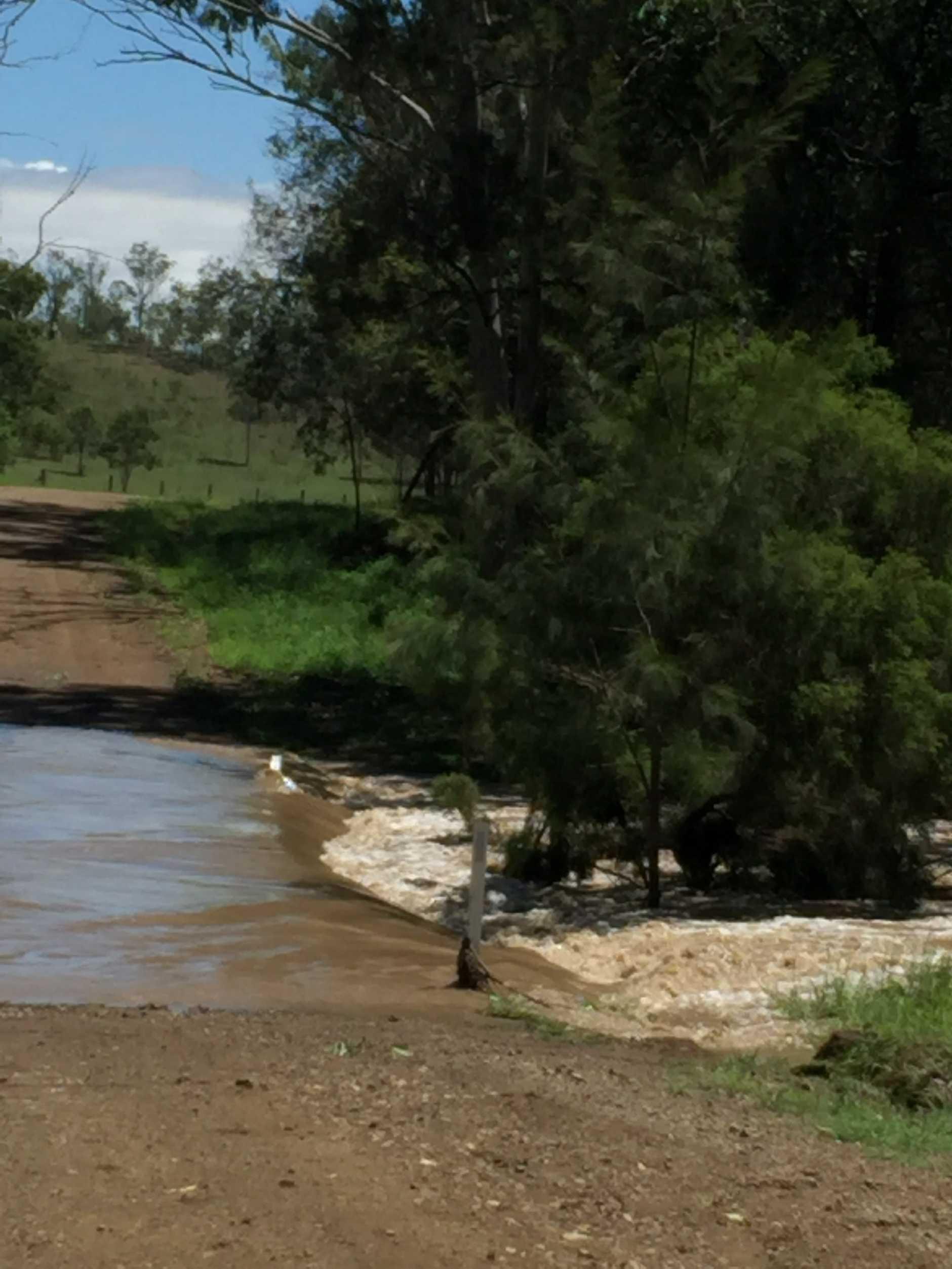Flood waters across Mt Shamrock Rd.