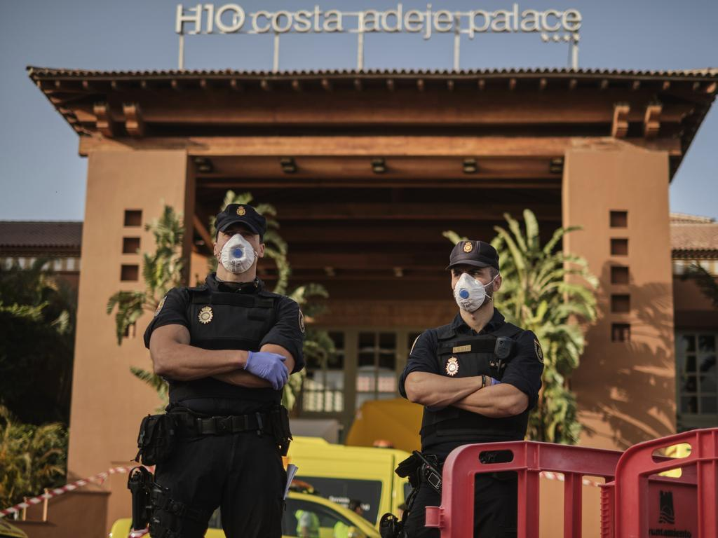 Police officers stand guard outside the H10 Costa Adeje Palace hotel in La Caleta, in the Canary Island of Tenerife in Spain. Picture: AP