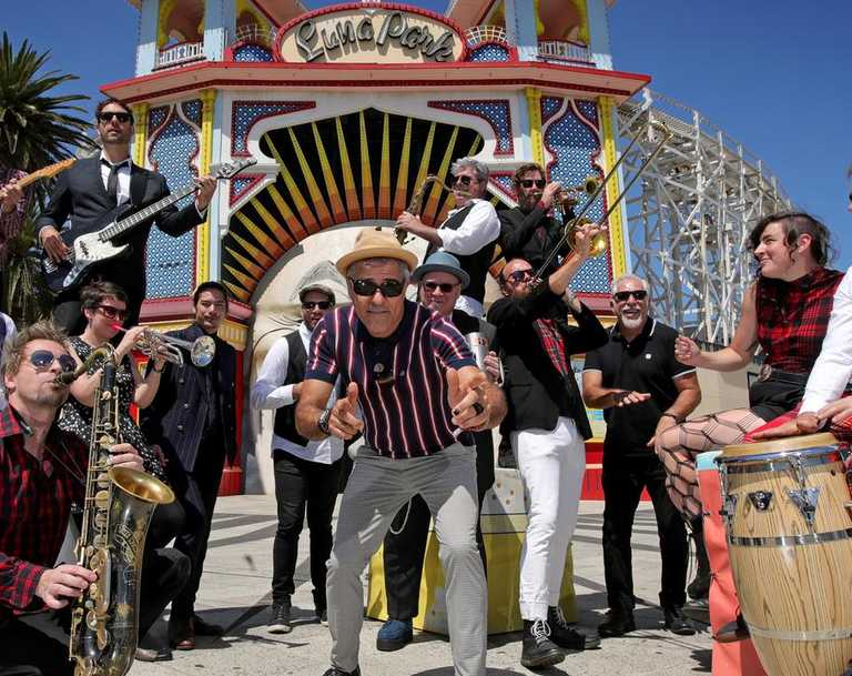 Band Leader Nicky Bomba (centre) and the Melbourne Ska Orchestra, outside Lunar Park in Melbourne. The orchestra plays Solbar this weekend. Picture: Stuart McEvoy/The Australian.