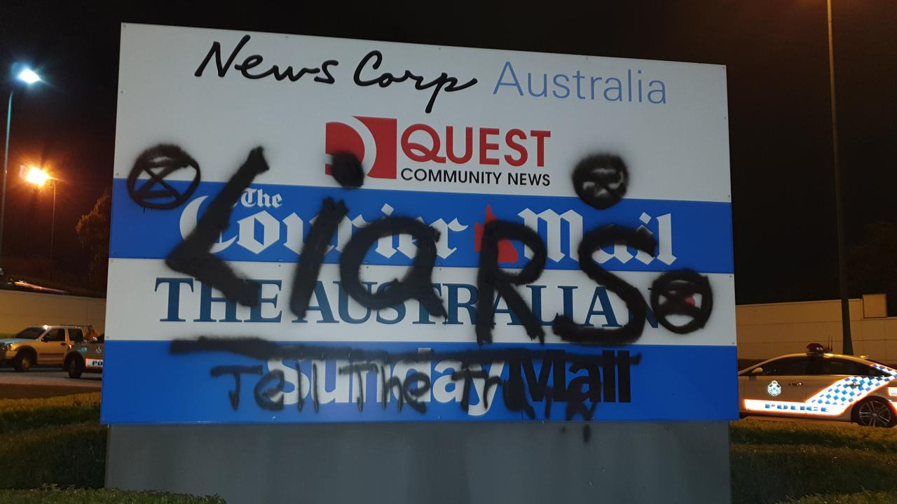 A sign was vandalised at News Corp's Brisbane printing press during an Extinction Rebellion protest.