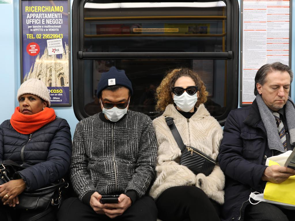 MILAN, ITALY - FEBRUARY 26: Two passengers of the subway are wearing a protective mask on February 26, 2020 in Milan, Italy. The country is struggling to understand how it went from six coronavirus cases to 374 cases and 12 dead since last Friday, becoming Europe's worst-affected country. Many communities across the Lombardy and Veneto regions have seen the suspension of public events and church