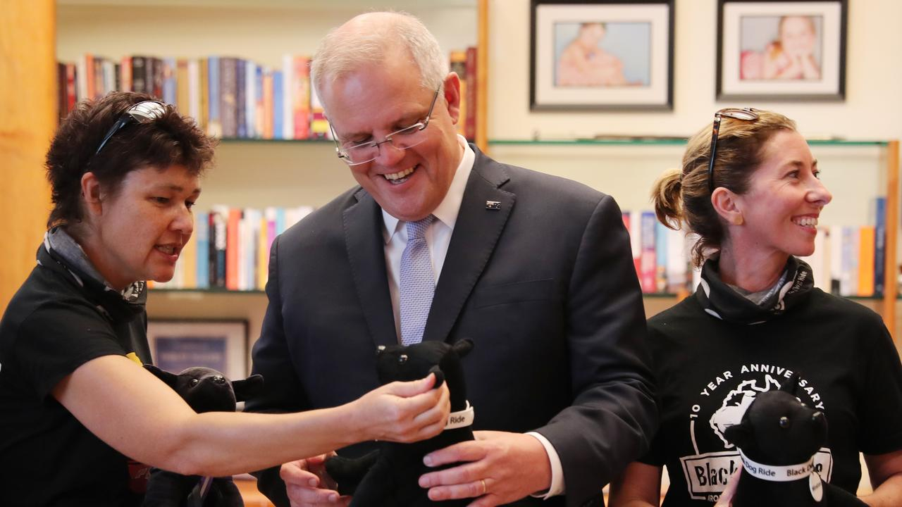 Prime Minister Scott Morrison being presented with