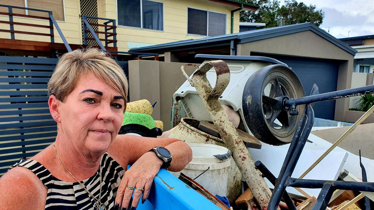 Therese Rowe, who's been living at Poinsettia Ave at Hollywell for 25 years, with one of the four skip bins her and her husband have filled since sewage flowed into their home. Picture: Luke Mortimer