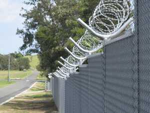 Mayor votes four times to keep razor wire fence near school