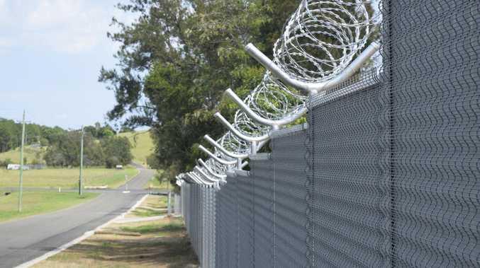 Mayor votes four times to keep razor wire fence near school