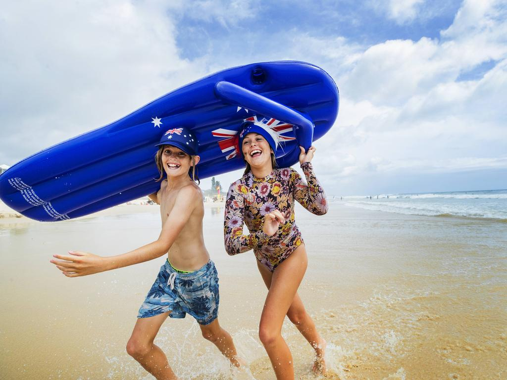 Siblings Layla 14, and Levi Johnstone, 11, get into the Australia Day Spirit at Coolum Beach. Photo: Lachie Millard