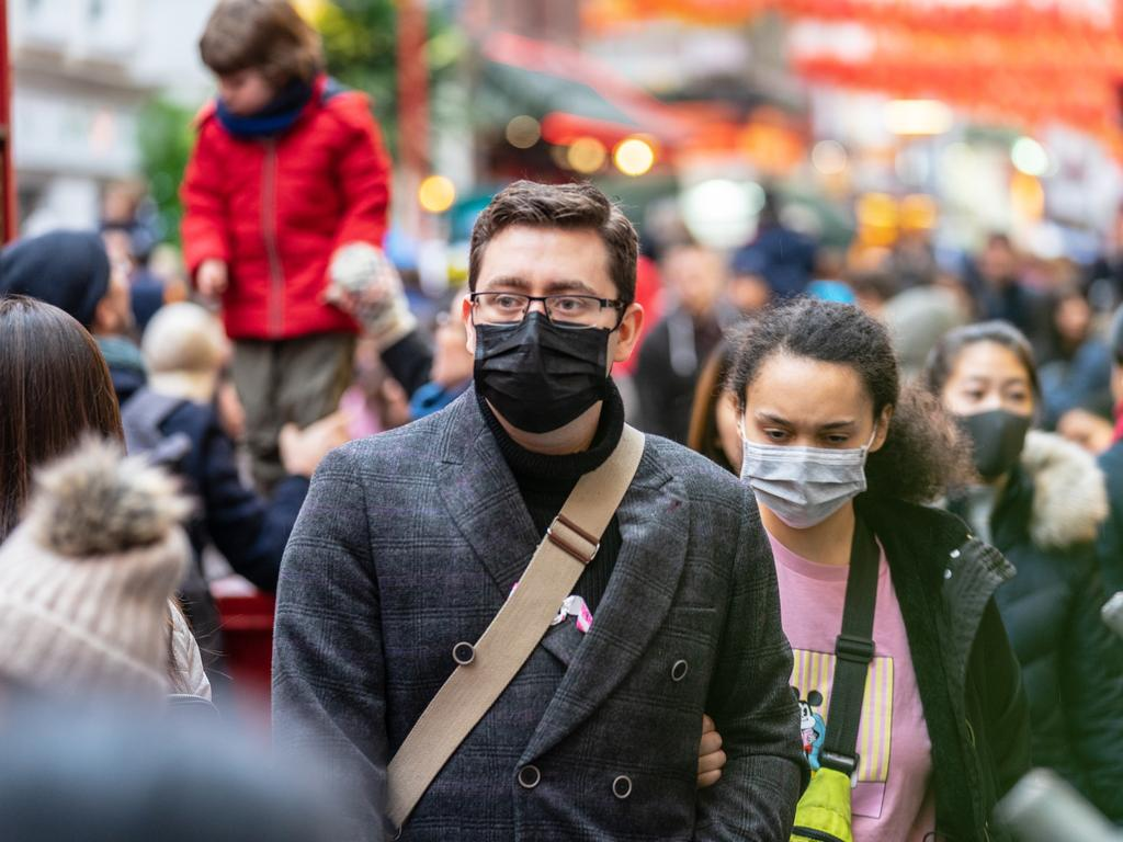 People wearing face masks in London. The outbreak has caused concern all around the world.