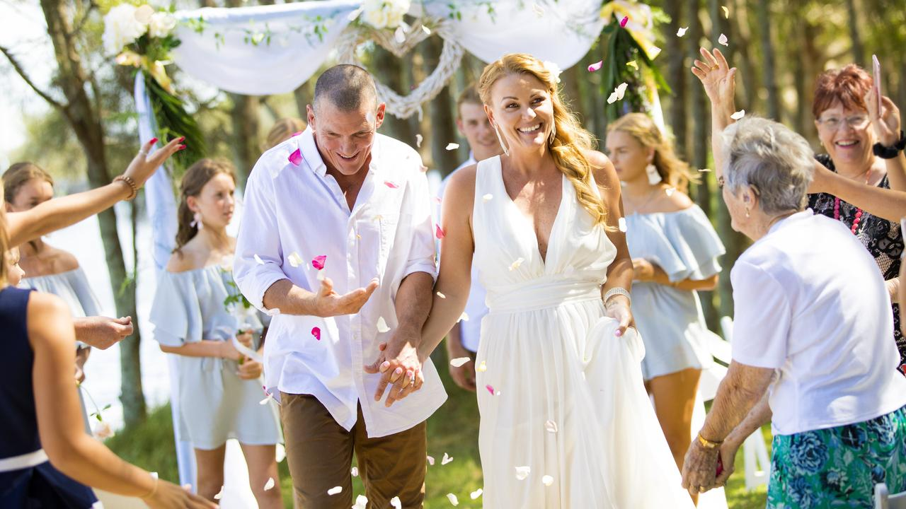 Adam and Trudy Maher married in a beautiful ceremony at Lake Currimundi in 2018. Photo: Cade Mooney