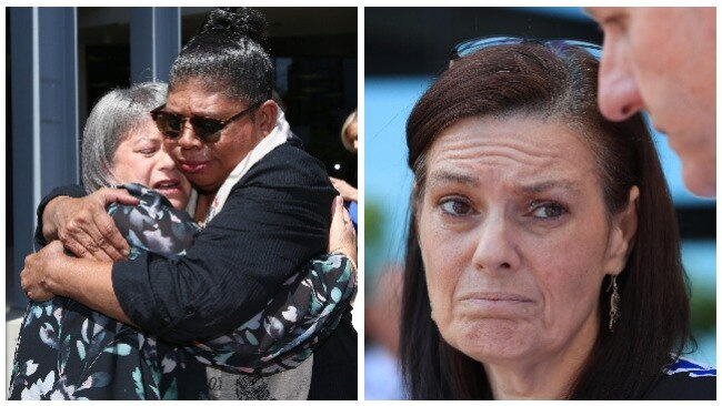 Donna Baluskas clutches the woman who approached her while Tracey Brose gave a statement outside court. Photo: Adam Head