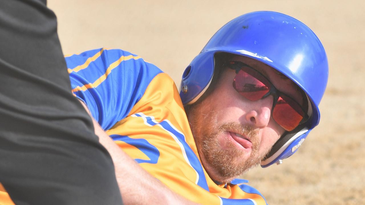 Hervey Bay softball - Terrors runner Michael Maclaren slides into third base.