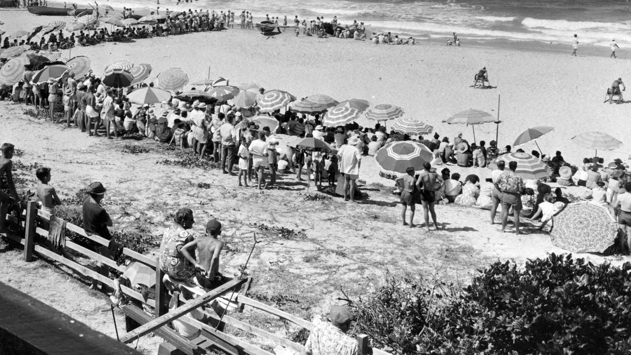 Spectators at a surf carnival, Mooloolaba Beach, 1950s.