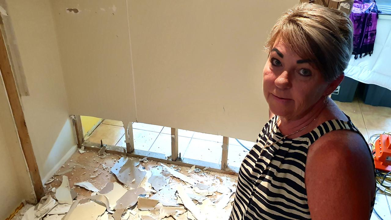 Therese Rowe inside the bottom level of her home at Poinsettia Ave, Hollywell. It's being torn apart after sewage flowed into the property. Picture: Luke Mortimer