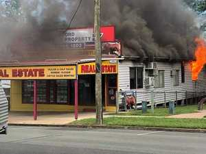 Building goes up in flames as crews fight to save business