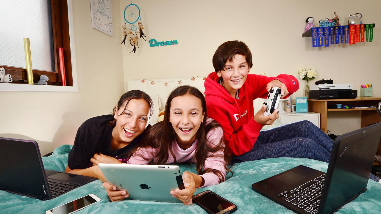 Paris, 16, Angelique, 11 and Jamiq, 14, enjoy playing their devices. Picture: Nicki Connolly