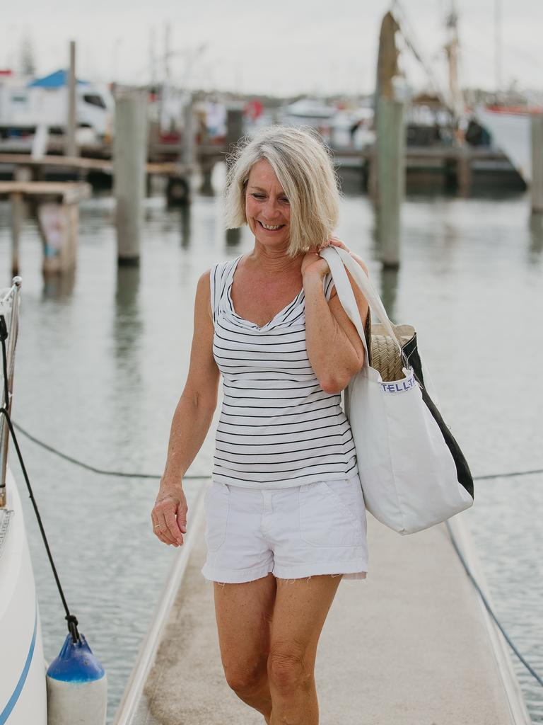 Telltale Designs owner Maree Machin with one of her bags, made from repurposed boat sails.