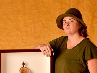 "Kangaroo Island artist Lara Tilbrook with her artwork ""Fat Cat"". Photo Sam Wundke / AAP Photo."