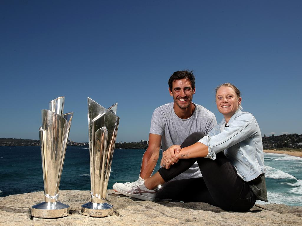 Two of a kind … cricket power couple Mitchell Starc and Alyssa Healy with the Women's and Men's ICC T20 World Cup trophies.