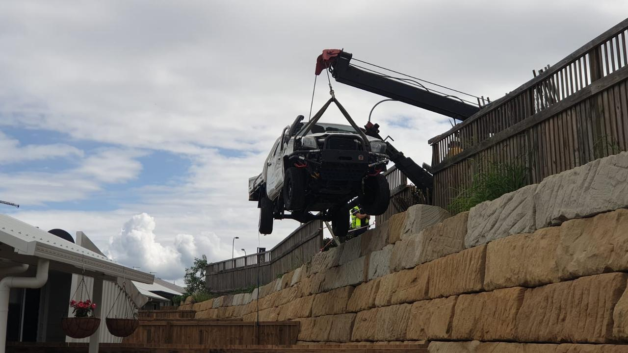 A crane lifts the ute from the Collingwood Park property. Picture: Supplied
