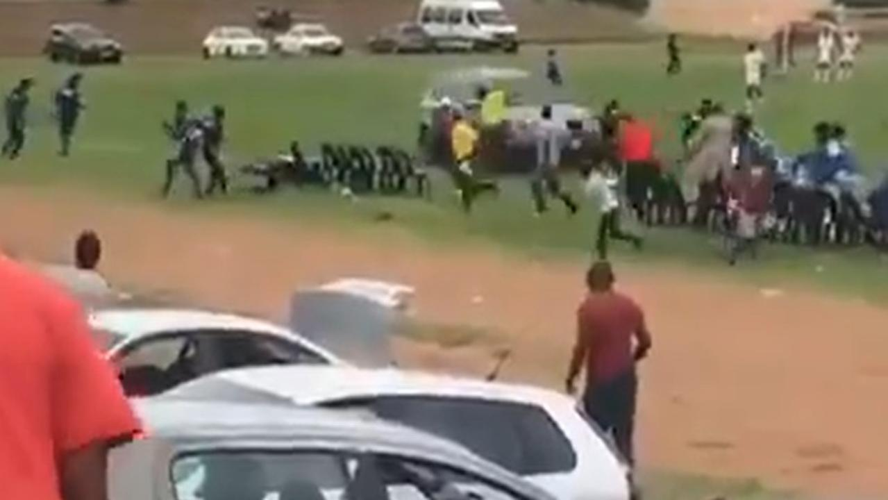 The horror moment a maniacal fan drives his car straight at an opposition team after chasing a referee has left the sporting world in shock.