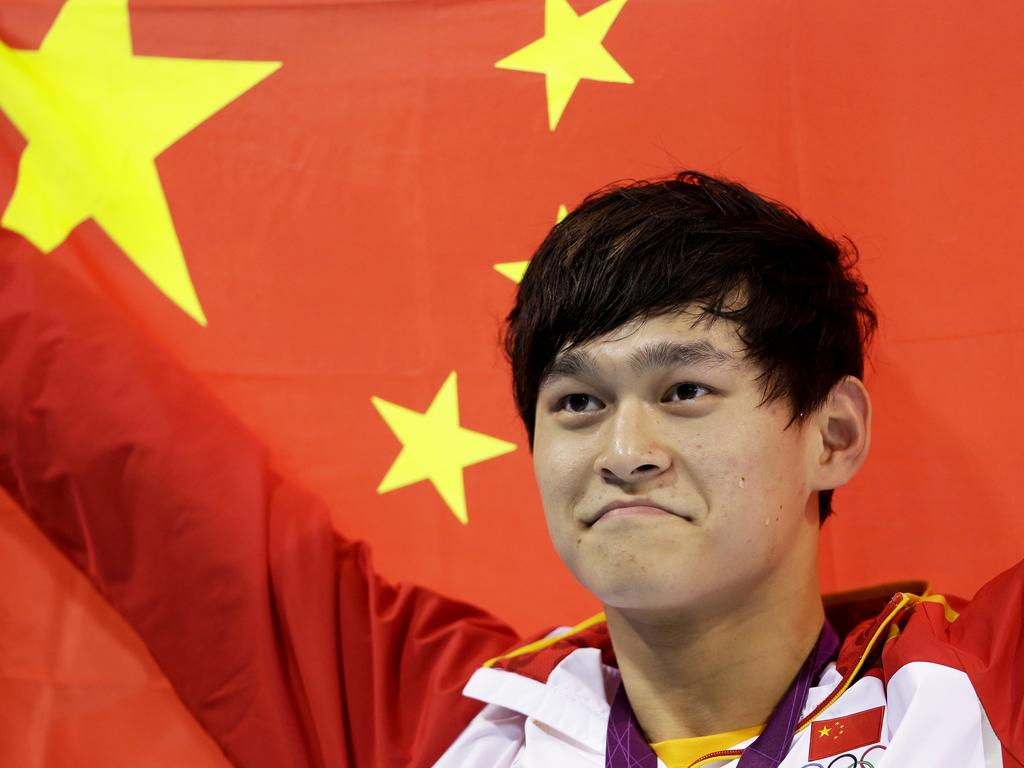 China's Sun Yang holds his national flag after winning the gold medal in the men's 1500m at the 2012 Olympics. (AP Photo/Lee Jin-man, File)