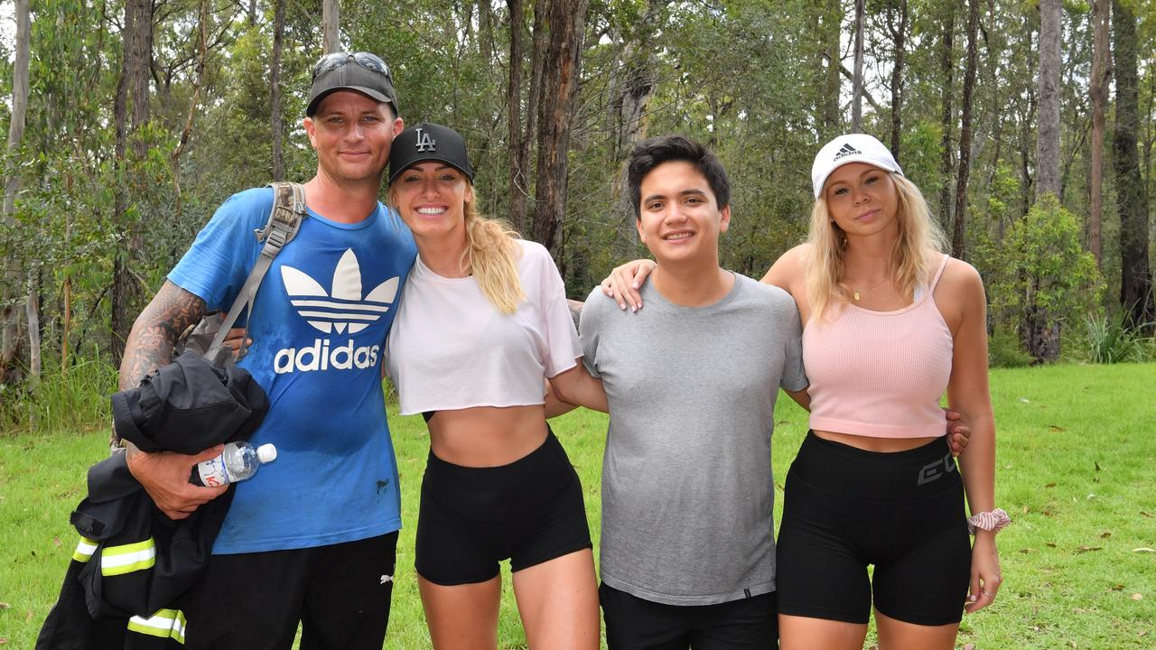 A group of people needed to be rescued from Mt Tibrogargan after a heavy downpour of rain made descent difficult.Tayla Crowther, Emma Pearson and Matthew Walsh with auxillary firefighter Matt Mohr who was first on scene to assist. Photo: John McCutcheon / Sunshine Coast Daily