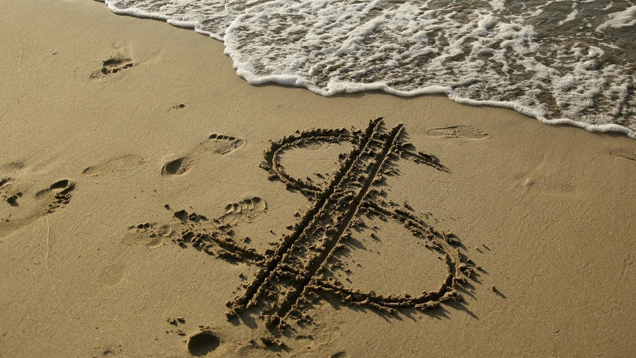 dollar sign on beach