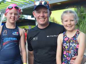 Kids swim, ride and run at race beside the river