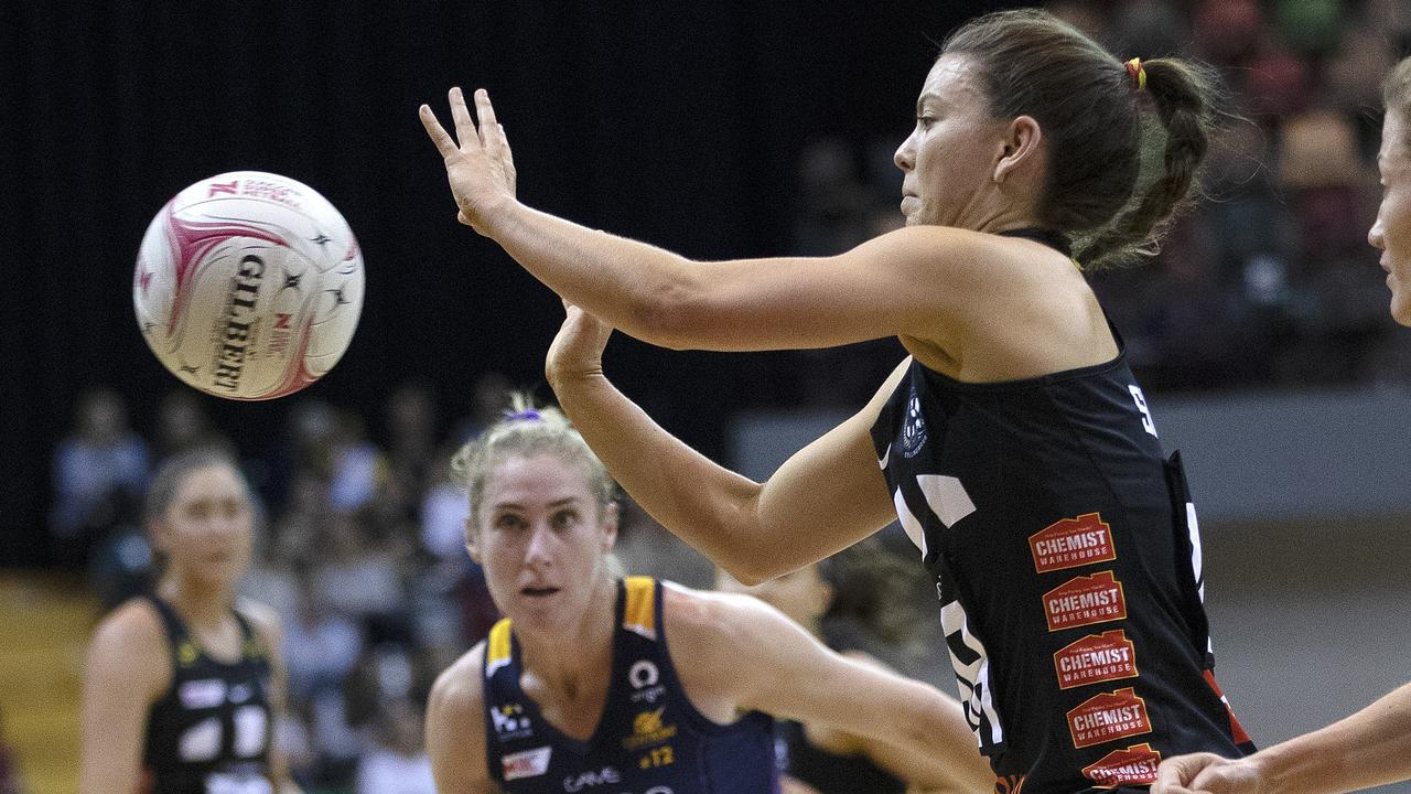 UNDER PRESSURE: Magpies Gabby Sinclair catches the ball as Lightning's Jacqui Russell closes in during their pre-season game at Hobart on Friday. Picture: Chris Kidd