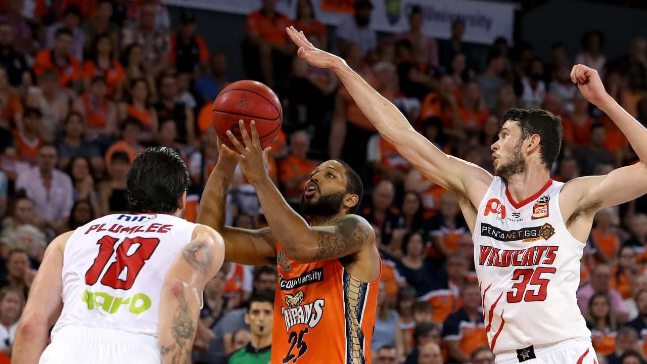 D.J. Newbill of the Cairns Taipans with Miles Plumlee and Clint Steindl of the Perth Wildcats during the second NBL Semi-Final match between the Cairns Taipans and the Perth Wildcats at the Cairns Convention Centre in Cairns, Sunday, March 1, 2020. (AAP Image/Marc McCormack)