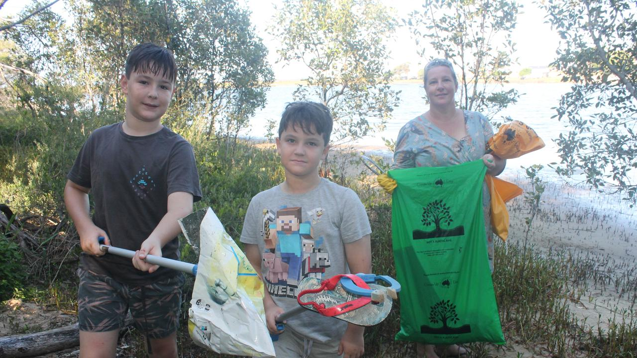 COLLECTING RUBBISH; Cubs from the 1st Ballina Scouts Harvey (left) and Archie Lewis, with mum Sam Jones, clean up at Ballina's Pop Denison Park on Sunday's Clean Up Australia Day.