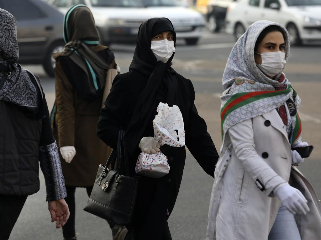 Women in face masks cross a square in western Tehran, Iran, where the number of coronavirus cases and deaths is spiralling. Picture: Vahid Salemi.