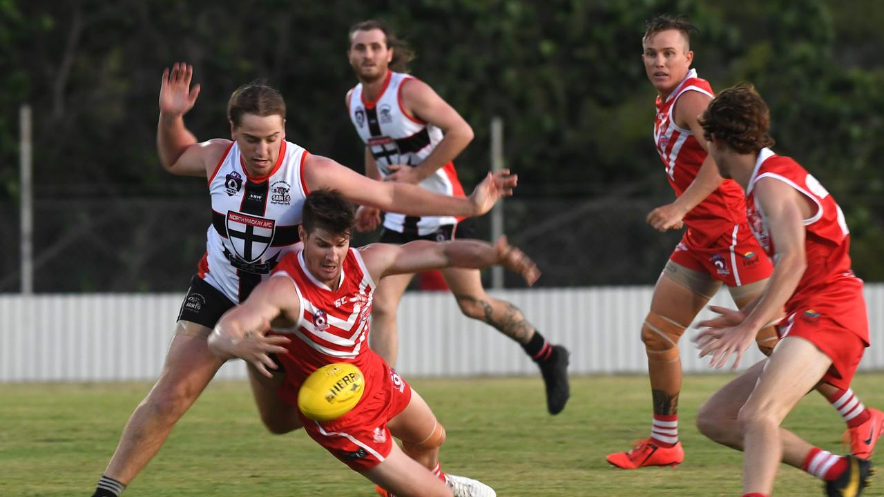 AFL CHALLENGE CUP: Yeppoon Swans' Thomas Cossens has his eye on the ball