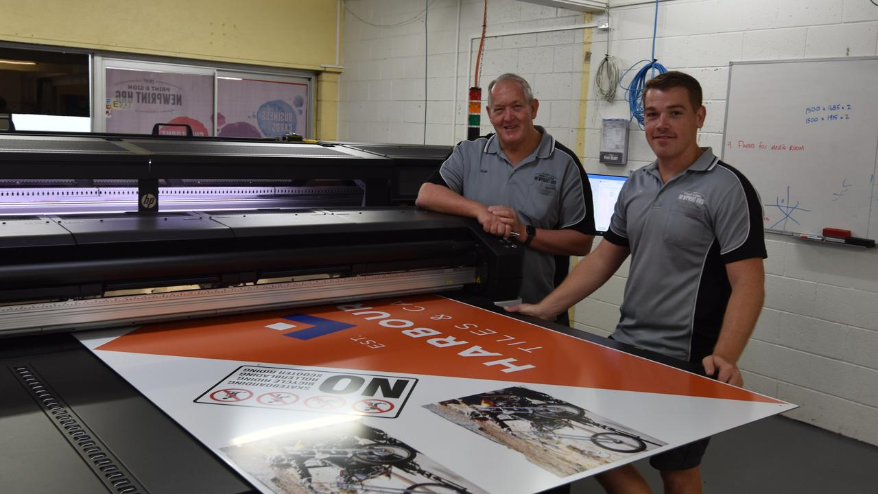 Wade and Ben Hughes are excited about their new printer, the first of its kind in regional Australia