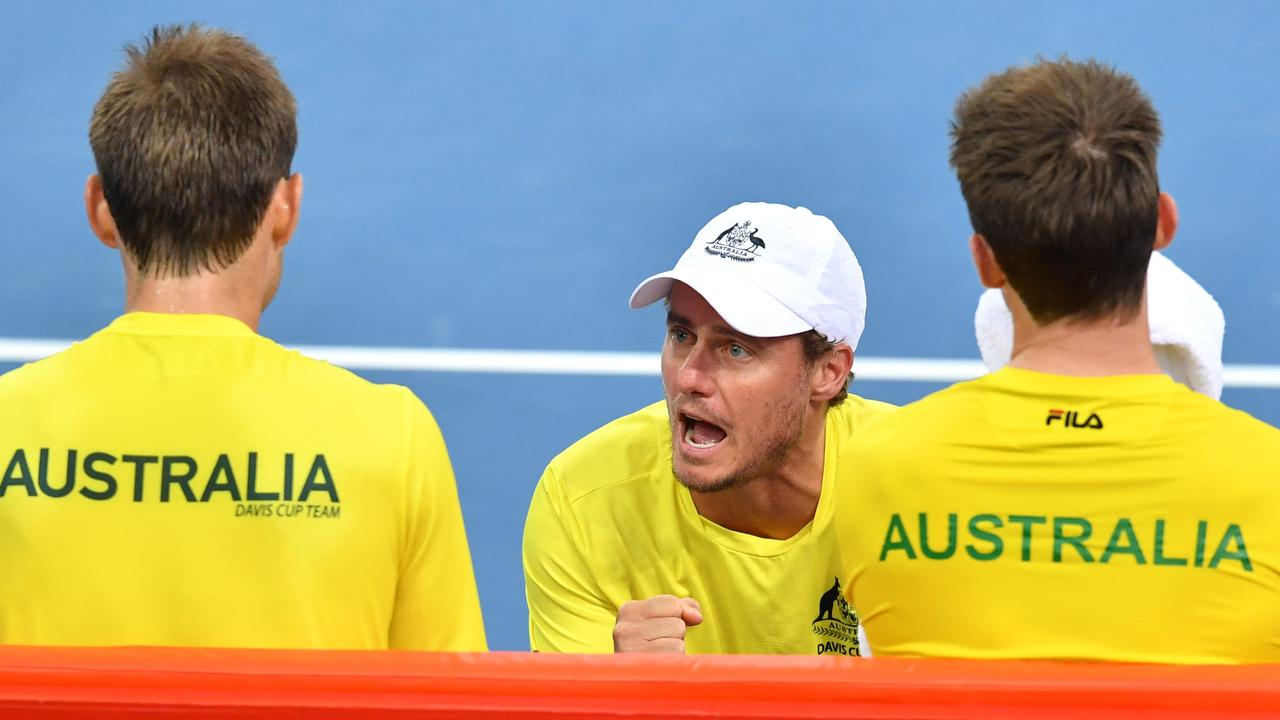 Australian team captain Lleyton Hewitt (centre) talking to Matt Ebden and John Peers of Australia during their Davis Cup doubles match between Australia and Germany in Brisbane 2018. Picture: AAP Image/Darren England