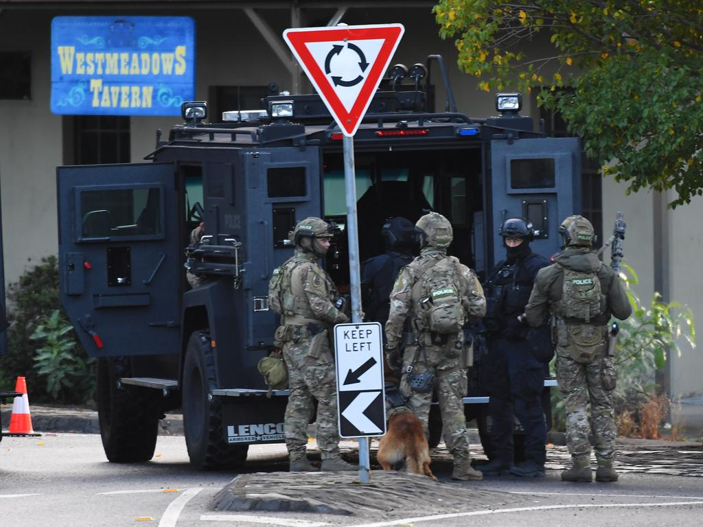 Armed police are seen outside the Westmeadows Tavern where a suspected siege is underway. Picture: AAP